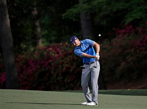 Jordan Spieth hits a chip shot during the first round of the Masters golf tournament Thursday, April 9, 2015, in Augusta, Ga.