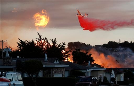 In this Sept. 9, 2010, file photo, a massive fire following a pipeline explosion roars through a mostly residential neighborhood in San Bruno, Calif.