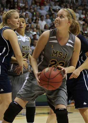 In this Nov. 2, 2014, file photo, Mount St. Joseph's Lauren Hill catches a pass and prepares to shoot during her first NCAA college basketball game, against Hiram University,  at Xavier University in Cincinnati.