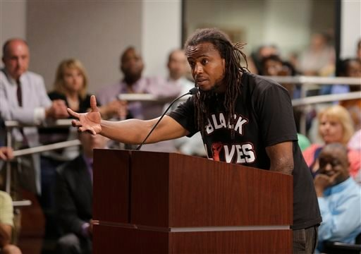 Muhiyidin D'Baha speaks during a meeting with North Charleston city council about the killing of Walter Scott by a North Charleston police officer Saturday, after a traffic stop in North Charleston, S.C., Thursday, April 9, 2015. The officer, Michael Thom