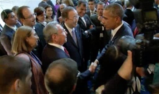 This image from the host broadcaster pool video shows U.S. President Barack Obama and Cuban President Raul Castro exchange handshakes on Friday April 10, 2015, at the opening of the Summit of the Americas in Panama. (AP Photo/Host Broadcaster Pool Video v