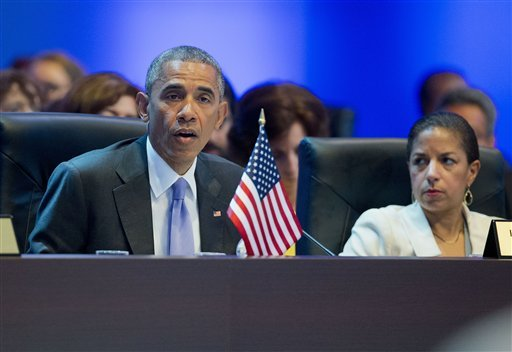 US President Barack Obama speaks as he joins other world leaders for the opening plenary of the Summit of the Americas in Panama City, Panama, Saturday, April 11, 2015. Listening to Obama's remarks is National Security Advisor Susan Rice, right. (AP Photo