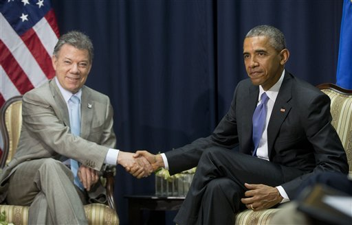 US President Barack Obama, right, shakes hands with Colombian President Juan Manuel Santos, left, during their bilateral meeting at the Summit of the Americas in Panama City, Panama, Saturday, April 11, 2015. (AP Photo/Pablo Martinez Monsivais)