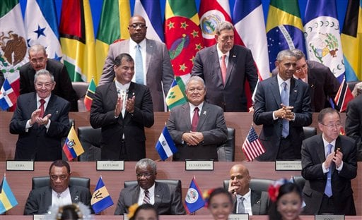 President Barack Obama, right middle row, and Cuba's President Raul Castro, left middle row, applaud with other leaders during the inauguration ceremony of the Summit of the Americas in Panama City, Friday, April 10, 2015. Obama is looking to the Summit o