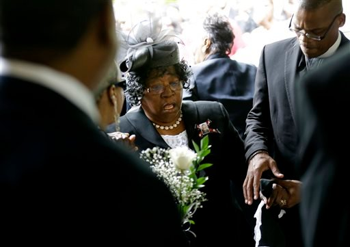 Judy Scott is escorted in for the funeral of her son, Walter Scott, at W.O.R.D. Ministries Christian Center, Saturday, April 11, 2015, in Summerville, S.C. Scott was killed by a North Charleston police officer after a traffic Saturday, April 4, 2015. The