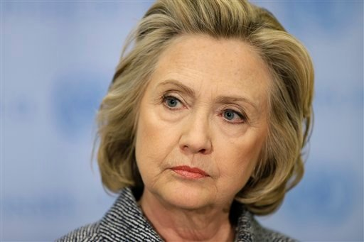 In this March 10, 2015 file photo, Hillary Rodham Clinton speaks to the reporters at United Nations headquarters. Rodham Clinton's presidential campaign will center on boosting economic security for the middle class and broadening opportunities for workin