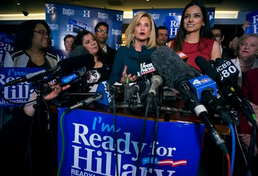 Rep. Carolyn Maloney, D-N.Y., center, speaks as Jenifer Rajkumar, at right looks on, during part of the Ready for Hillary campaign, Saturday, April 11, 2015, in New York. Dozens of supporters, elected officials and Democratic leaders gathered at the fundr