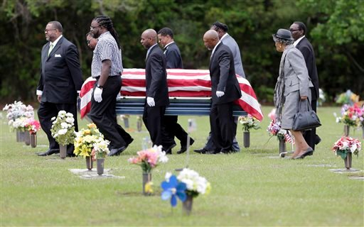 Pallbearers walk Walter Scott's casket to the gravesite for his burial service in Charleston, S.C. on Saturday, April 11, 2015. Scott was fatally shot by a North Charleston, S.C., police officer a week earlier after a traffic stop. Officer Michael Slager