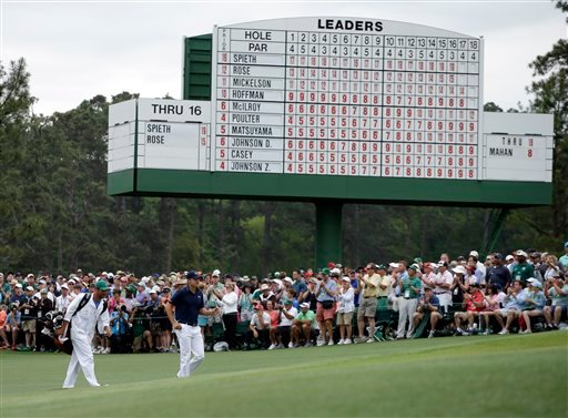 Jordan Spieth walks up the 18th fairway with his caddie Michael Greller during the fourth round of the Masters golf tournament Sunday, April 12, 2015, in Augusta, Ga. (AP Photo/Darron Cummings)