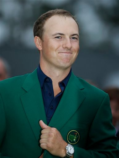 Jordan Spieth wears his green jacket after winning the Masters golf tournament Sunday, April 12, 2015, in Augusta, Ga. (AP Photo/Charlie Riedel)