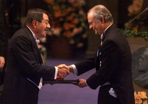 In this Dec. 10, 1999 file photo German author Guenter Grass, left, receives the Nobel Prize for literature from Swedish King Carl XVI Gustaf, right, at the Concert Hall in Stockholm, Sweden. Nobel laureate Grass has died his publishing house confirmed Mo