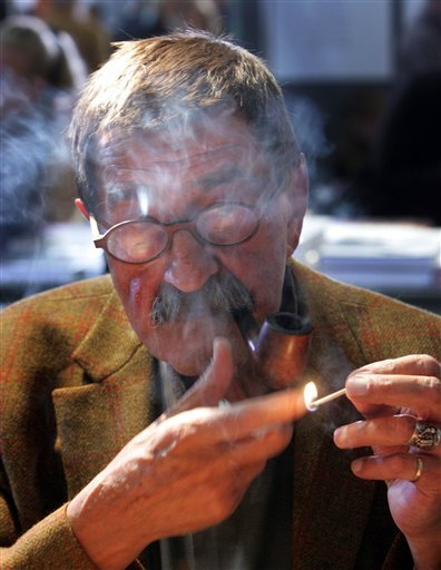 In this Oct. 6, 2006 file photo literature nobel prize winner Guenter Grass smokes a pipe at the Book Fair in Frankfurt, central Germany. Nobel laureate Grass has died his publishing house confirmed Monday, April 13, 2015. He was 87. (AP Photo/Michael Pro