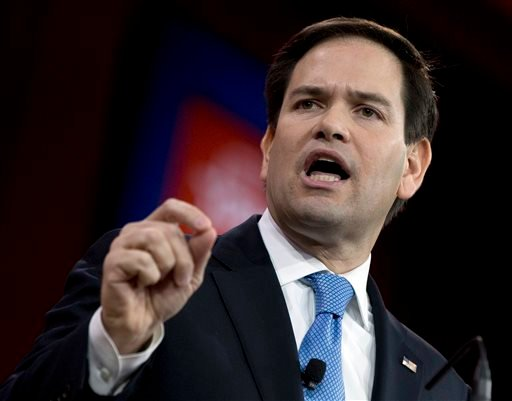In this Feb. 27, 2015 file photo, Sen. Marco Rubio, R-Fla. speaks in National Harbor, Md. When Rubio launches his Republican presidential campaign Monday, he'll have to answer a simple question. Why now? Rubio, a rising star on Capitol Hill, is just 43 y