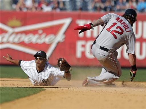 New York Yankees' Gregorio Petit (31) reacts as Boston Red Sox's Mike Napoli (12) steals second base during the ninth inning of a baseball game Saturday, April 11, 2015, in New York. The Red Sox won 8-4. (AP Photo/Frank Franklin II)