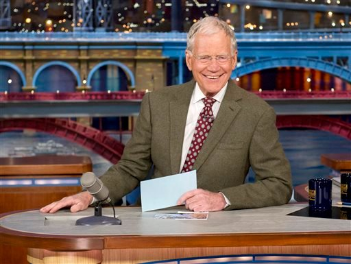 """April 3, 2014 file photo provided by CBS: David Letterman, host of the """"Late Show with David Letterman,"""" smiles after announcing his retirement during a taping in New York. Letterman will host his final show on May 20.(AP Photo/CBS, Jeffrey R. Staab)"""