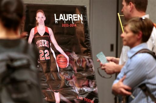 People pay their respects to the 19-year-old basketball player Lauren Hill during a public visitation Monday, April 13, 2015, at Xavier University in Cincinnati. Hill died Friday from a brain tumor that had been growing inside of her for more than a year.