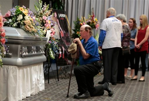 People pay their respects to the 19-year-old Mount St. Joseph basketball player Lauren Hill during a public visitation Monday, April 13, 2015, at Xavier University in Cincinnati. Hill died Friday from a brain tumor that had been growing inside of her for