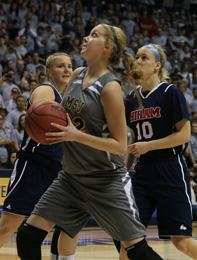 In this Nov. 2,k 2014, file photo, Mount St. Joseph's Lauren Hill shoots a lay up during her first NCAA college basketball game against Hiram University at Xavier University in Cincinnati. The 19-year-old freshman basketball player died at a hospital in