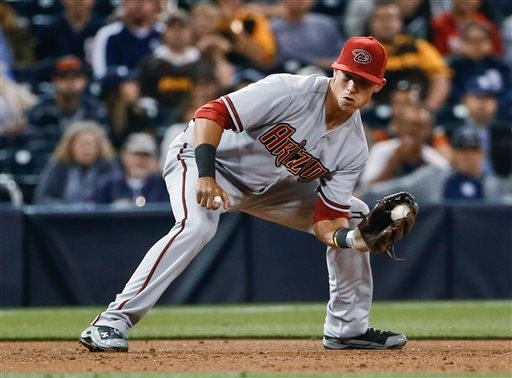 Arizona Diamondbacks third baseman Jake Lamb snares a hard grounder hilt by San Diego Padres' Justin Upton during the second inning of a baseball game Monday, April 13, 2015, in San Diego. Lamb got the out at first. (AP Photo/Lenny Ignelzi)