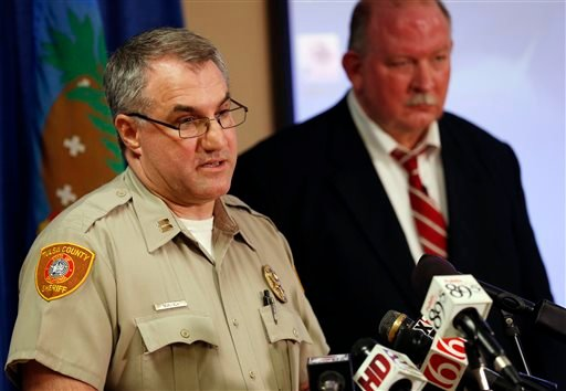 In this Friday, April 10, 2015, photo, Tulsa County Sheriff's Office Capt. Billy McKelvey, left, speaks next to Jim Clark, an independent consultant, during a news conference about the investigation of the death of Eric Harris in Tulsa, Okla. Police say a