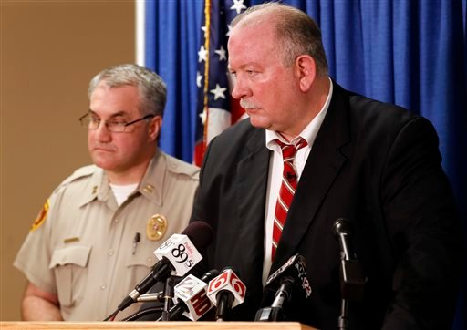 In this Friday, April 10, 2015, photo, Jim Clark, right, an independent consultant, speaks next to Tulsa County Sheriff's Office Capt. Billy McKelvey during a news conference about the investigation of the death of Eric Harris in Tulsa, Okla. Police say a