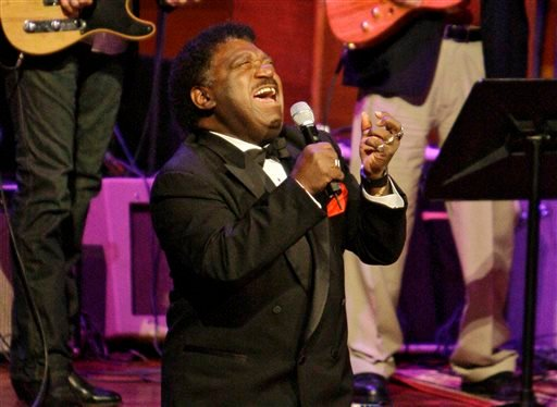 """In this Oct. 28, 2008 file photo, Percy Sledge kneels as he performs """"When a Man Loves a Woman"""" along with the Muscle Shoals Rhythm Section at the Musicians Hall of Fame awards show in Nashville, Tenn."""