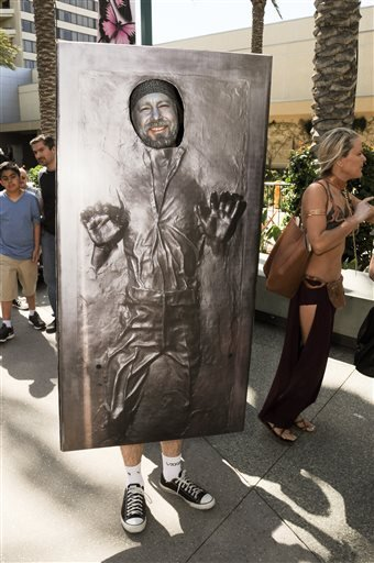 A Star Wars Fan waits in line to enter the Star Wars Celebration: The Ultimate Fan Experience held at the Anaheim Convention Center on Thursday, April 16, 2015, in Anaheim, Calif.