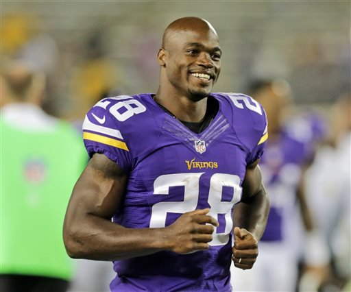 In this Aug. 8, 2014, file photo, Minnesota Vikings running back Adrian Peterson leaves the field after an NFL preseason football game against the Oakland Raiders in Minneapolis.