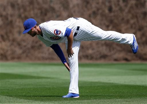 Chicago Cubs' Kris Bryant stretches on the field before a baseball game against the San Diego Padres in Chicago, Friday, April 17, 2015.