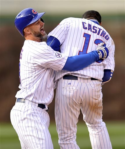 Chicago Cubs' David Ross (3), celebrates with teammate Starlin Castro (13), after Castro hit a walk off single to defeat the San Diego Padres 7-6 after eleven innings of an MLB baseball game Saturday, April 18, 2015, in Chicago. (AP Photo/Paul Beaty)