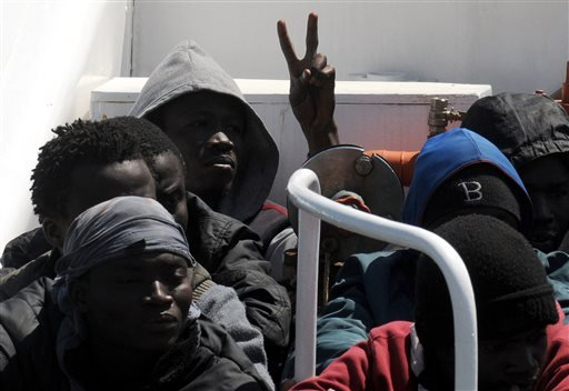 Migrants arrive at Palermo's harbor, Italy, after being rescued at sea, Wednesday, April 15, 2015. The U.N. refugee agency says the shipwreck in the Mediterranean this week, in which 400 migrants are presumed to have died, is among the deadliest single in