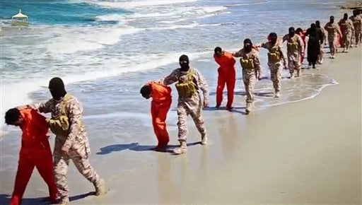 This undated image made from a video released by Islamic State militants, Sunday, April 19, 2015, appears to show the killing of a group of captured Ethiopian Christians in Libya. The 29-minute video released online Sunday purportedly shows two groups of