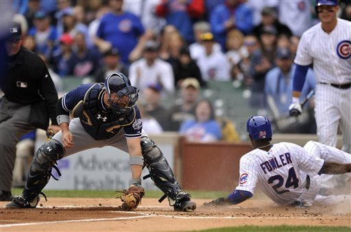 San Diego Padres catcher Derek Norris (3), attempts to apply the tag as Chicago Cubs' Dexter Fowler (24), slides safely at home plate on a Jorge Soler single during the first inning of an MLB baseball game Sunday, April 19, 2015, in Chicago. (AP Photo/Pau