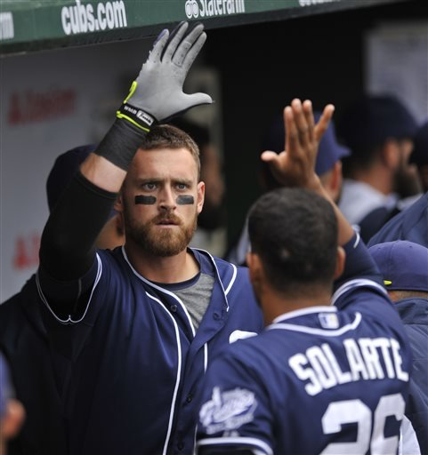 San Diego Padres' Will Middlebrooks, left, celebrates with teammate Yangervis Solarte (26) in the dugout after hitting a two-run home run during the second inning of a baseball game against the Chicago Cubs, Sunday, April 19, 2015, in Chicago. (AP Photo/P