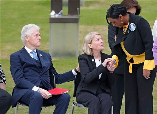 Former President Bill Clinton, left, and former state Rep. Susan Winchester, center, the chairman of the the Oklahoma City National Memorial Foundation, console Helena Garrett, right, the mother of bombing victim Tevin Garrett, right, after Garret spoke d