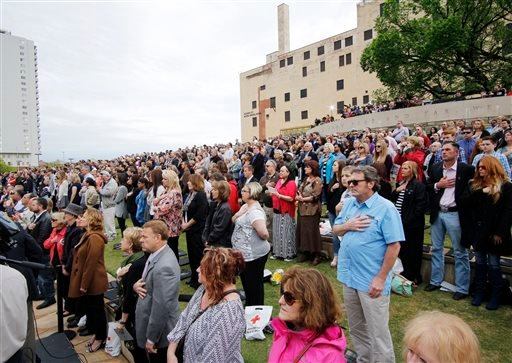 People listen during a remembrance ceremony, Sunday, April 19, 2015, at the Oklahoma City National Memorial & Museum in Oklahoma City. People gathered at the former site of the Oklahoma City federal building to commemorate the 20th anniversary of the terr