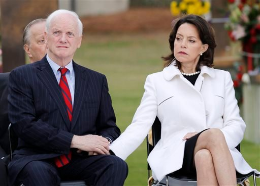 Former Gov. Frank Keating and his wife, Cathy, hold hands during a remembrance ceremony, Sunday, April 19, 2015, at the Oklahoma City National Memorial & Museum in Oklahoma City. About 1,000 people gathered at the former site of the Oklahoma City federal