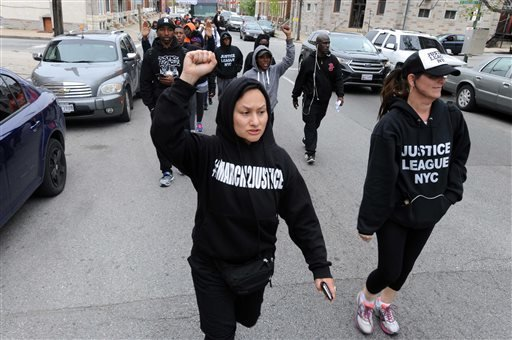Citizens and groups such as the Justice League of NYC protest following the death of Freddie Gray, Sunday, April 19, 2015, in Baltimore. Gray, 25, of Baltimore, died Sunday at a hospital, a week after he was hurt following an arrest. (Algerina Perna/The B