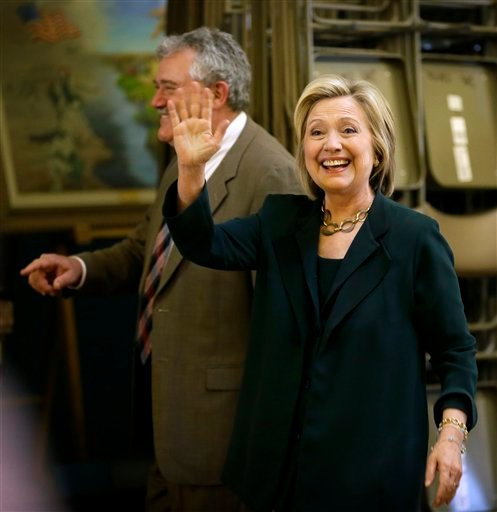 Democratic presidential candidate Hillary Rodham Clinton waves as she arrives at the Iowa Statehouse to meet with Democratic Party lawmakers, Wednesday, April 15, 2015, in Des Moines, Iowa. (AP Photo/Charlie Neibergall)