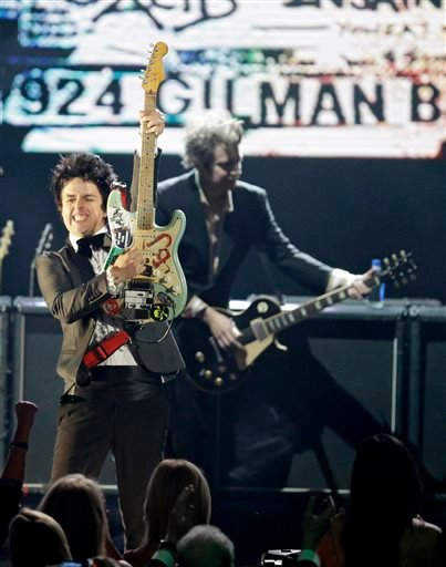 Billie Joe Armstrong, front, and Mike Dirnt, from Green Day perform at the Rock and Roll Hall of Fame Induction Ceremony Saturday, April 18, 2015, in Cleveland.