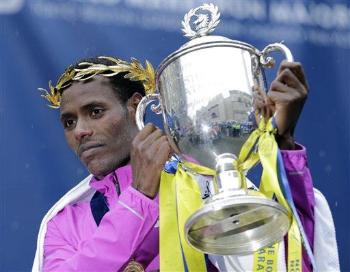Lelisa Desisa, of Ethiopia, lifts his trophy after winning the Boston Marathon, Monday, April 20, 2015 in Boston.