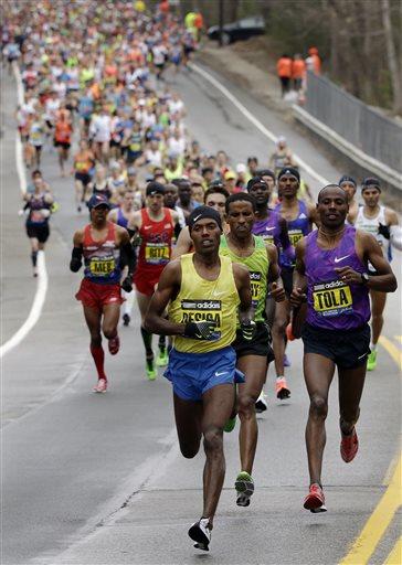 Lelisa Desisa, of Ethiopia, leads the pack through Hopkinton, Mass., en route to a win in the Boston Marathon, Monday, April 20, 2015, in Boston.