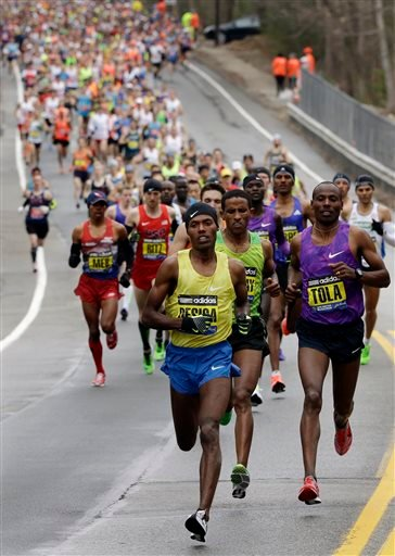 Lelisa Desisa, of Ethiopia, leads the pack through Hopkinton, Mass., en route to a win in the Boston Marathon, Monday, April 20, 2015, in Boston.