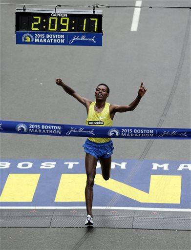 Lelisa Desisa, of Ethiopia, crosses the finish line to win the Boston Marathon, Monday, April 20, 2015, in Boston.