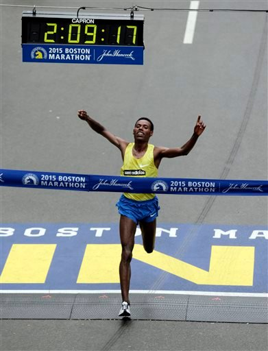 Lelisa Desisa, of Ethiopia, crosses the finish line to win the Boston Marathon, Monday, April 20, 2015, in Boston.