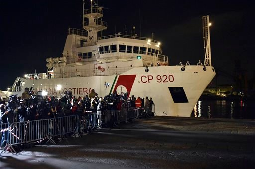 Italian Coast Guard ship Bruno Gregoretti, carrying survivors of the boat that overturned off the coasts of Libya Saturday, arrives at Catania Harbor, Italy, Monday, April 20, 2015. A smuggler's boat crammed with hundreds of people overturned off Libya's