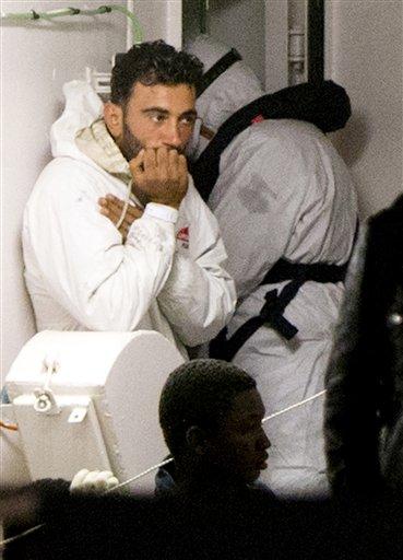 Mohammed Ali Malek, one of the survivors of the boat that overturned off the coast of Libya on Saturday, waits to disembark from Italian Coast Guard ship Bruno Gregoretti, at Catania Harbor, Italy, Monday, April 20, 2015. Mohammed Ali Malek and Mahmud Bik