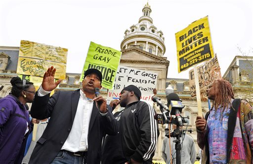 "Edward Brown speaks at a protest outside City Hall about Freddie Gray in Baltimore, Monday, April 20, 2015. Baltimore's top police officials, mayor and prosecutor sought to calm a ""community on edge"" Monday while investigating how Gray suffered a fatal sp"