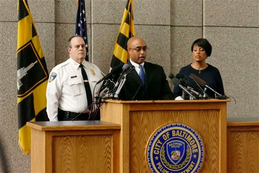 Police Commissioner Anthony W. Batts, center, speaks to the media at a news conference on the death of Freddie Gray with Deputy Commissioner Jerry Rodriguez, left, and Mayor Stephanie Rawlings-Blake in Baltimore, Monday, April 20, 2015. Baltimore's top po