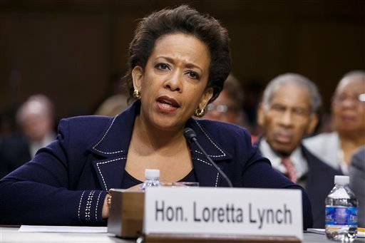 """In this Jan. 28, 2015 file photo, Attorney General nominee Loretta Lynch testifies on Capitol Hill in Washington. President Barack Obama on Friday said it was """"crazy"""" and """"embarrassing"""" the way the Republican-led Senate has held up confirmation of his at"""